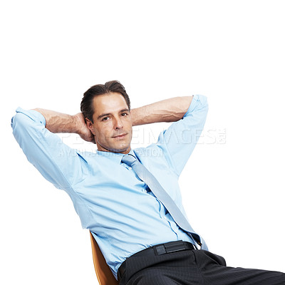 Buy stock photo Portrait of a relaxed mature businessman sitting on a chair against a white background