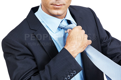 Buy stock photo Closeup shot of a businessman in a suit adjusting his necktie against white background