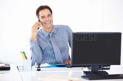 Buy stock photo Portrait of a mature business man talking on mobile phone while sitting at his desk at office
