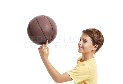 Buy stock photo Happy little boy trying to balance a basketball on finger isolated over white background