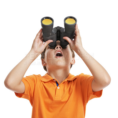 Buy stock photo Portrait of a little boy looking upwards through binoculars at copyspace against white background