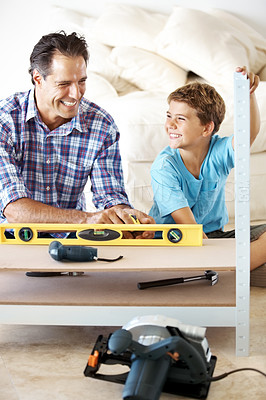 Buy stock photo Portrait of smiling father and cute sone working together in workshop