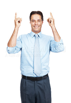 Buy stock photo Portrait of a smiling mature businessman pointing up at copyspace with both hands