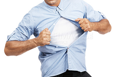 Buy stock photo Cropped image of a man pulling off his shirt against a white background