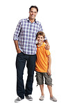 Caring father standing with his cute son isolated on white
