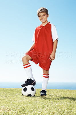 Buy stock photo Portrait of a happy cute little boy with soccer ball under his feet at ground - Outdoor