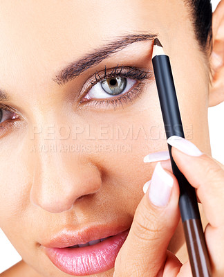 Buy stock photo Closeup portrait of a pretty young girl applying eyeliner