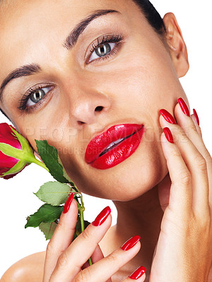 Buy stock photo Closeup portrait of a fashionable young woman posing with a red rose against white background