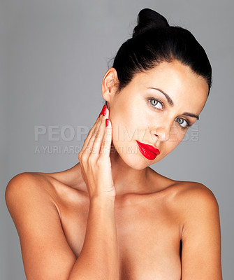 Buy stock photo Closeup portrait of a hot young lady posing confidently against grey background