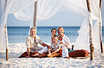 Happy family enjoying holidays on the beach