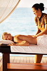 Woman receiving massage at spa resort