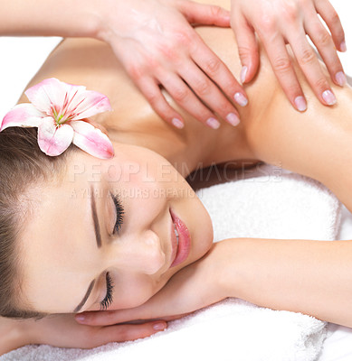 Buy stock photo Young female at the day spa. Portrait of a pretty young woman getting a massage at the day spa
