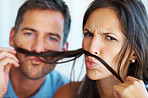Man and woman with fake mustache
