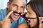 Couple teasing with fake mustache
