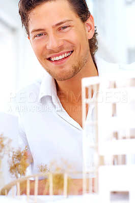 Buy stock photo A handsome Cropped shot of a young architect working on a new building planarchitect looking at you