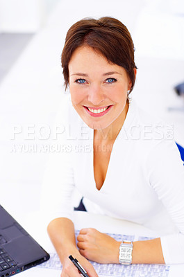 Buy stock photo Cropped shot of a businesswoman working in her office
