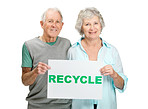 Sweet elderly couple holding recycle symbol