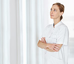 Mature nurse standing hands folded and looking at copyspace