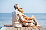 Mature couple spending romantic time together by the sea