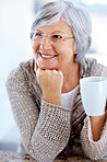 Senior female looking at something interesting with coffee
