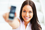 Gorgeous woman showing her cellphone and smiling at camera