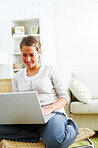 Modern life - woman sitting at home using laptop