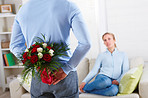 Romance - Romantic man hiding roses behind his back