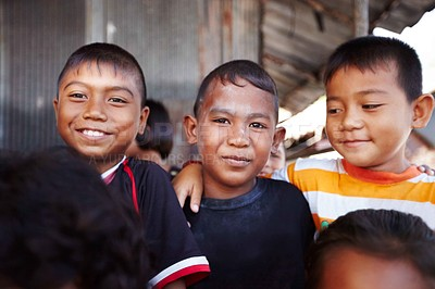 Buy stock photo Three young Thai children expressing friendship while standing together