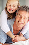Cute young girl and father in a playful mood
