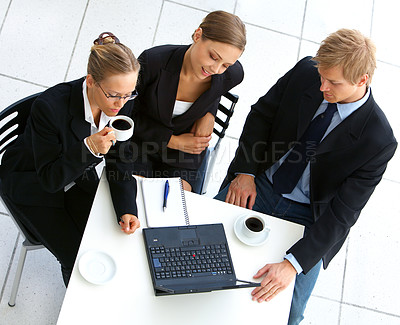 Buy stock photo Cropped shot of three business colleagues working in a cafe