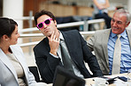 Funny man wearing a pink framed sunglasses for a meeting