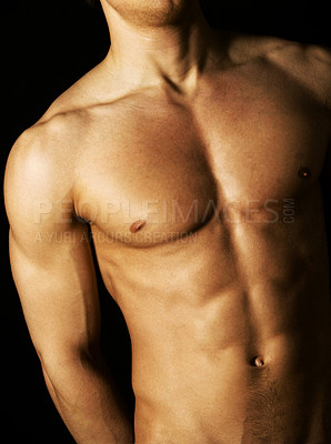 Buy stock photo Cropped studio shot of a fit bare-chested male model isolated on black