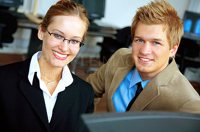 Buy stock photo On location picture of man and woman in a computer room