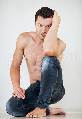 Buy stock photo Portrait of sexy shirtless man sitting down on floor
