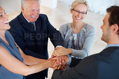 Buy stock photo Portrait of smiling business people joining hands together