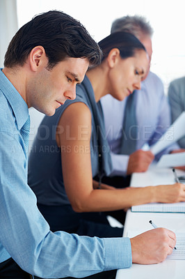 Buy stock photo Portrait of business people taking notes during presentation in office