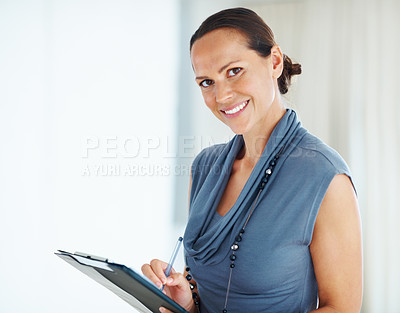 Buy stock photo Portrait of smiling mixed race woman taking notes while looking at you