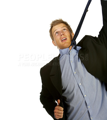 Buy stock photo A trendy businessman with a blue tie and shirt hanging himself