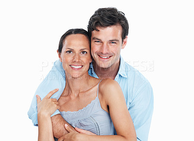Buy stock photo Portrait of handsome man embracing pretty woman on white background
