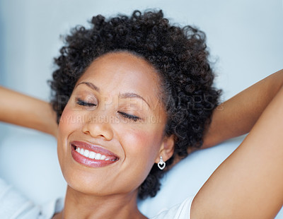 Buy stock photo Closeup of beautiful African American woman relaxing with hands behind head