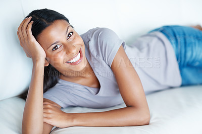 Buy stock photo Portrait of attractive mixed race woman with great smile relaxing on sofa