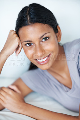 Buy stock photo Portrait of beautiful mixed race woman relaxing on couch