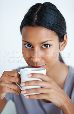 Buy stock photo Closeup of attractive mixed race woman drinking coffee.