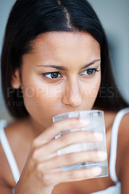 Buy stock photo Closeup of beautiful mixed race woman drinking water