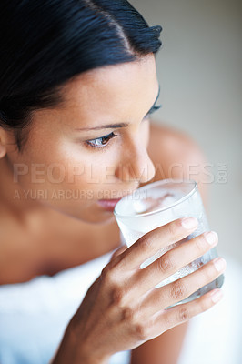 Buy stock photo Closeup of pensive mixed race woman drinking water
