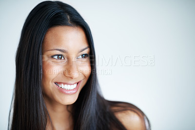 Buy stock photo Closeup of attractive woman with long black hair smiling on plain background