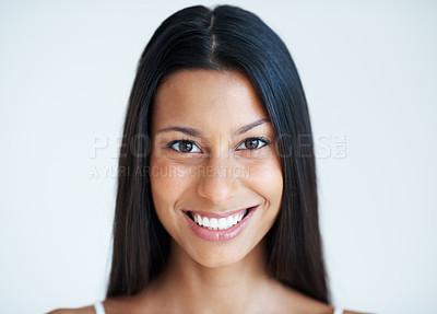 Buy stock photo Closeup portrait of pretty mixed race woman smiling on plain background