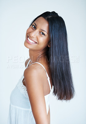 Buy stock photo Portrait of beautiful mixed race woman with healthy black hair smiling on plain background