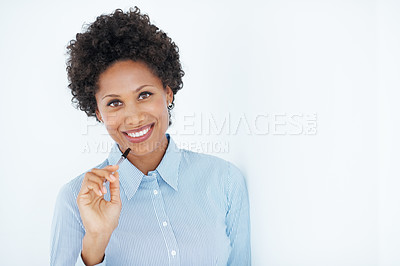 Buy stock photo Portrait of smiling African American female executive holding pen against chin