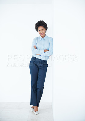 Buy stock photo Full length of smiling African American business woman leaning against wall